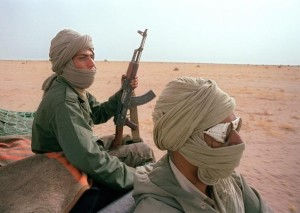 (FILES) Polisario fighters patrol near the 1600kms long, Moroccan defensive walls, 15 June 1988, in Polisario-controlled Western Sahara. The Polisario Front threatened 21 December 2007 to resume war against Morocco if the negotiations in New York 07-09 January 2008 to end the conflict fail. The Polisario front, an armed movement backed by Algeria, is fighting for the independence of Western Sahara, a former colony of Spain that was invaded and annexed by Morocco in 1975. AFP PHOTO / MIKE NELSON (Photo credit should read MIKE NELSON/AFP/Getty Images)